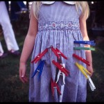 child with clothes pin pinned to her dress