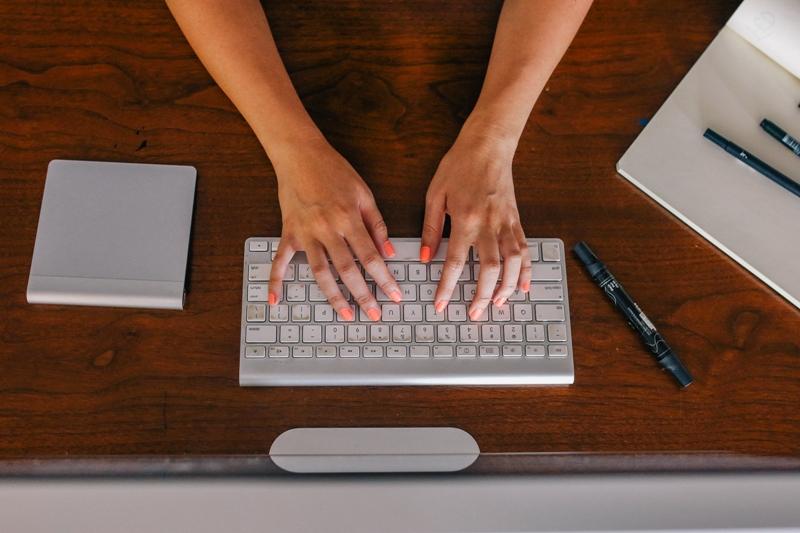 fingers on a mac keyboard